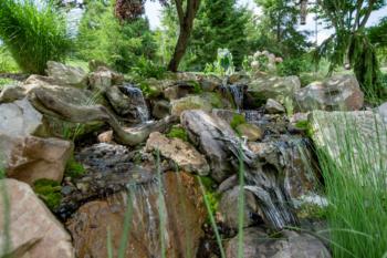 Rocky backyard waterfall installation