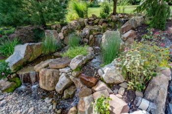Waterfall cascading down a client's backyard