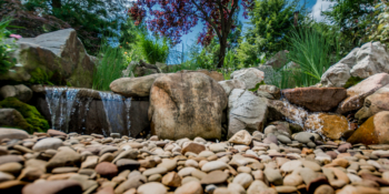 Wide angle shot of our waterfall design over some large boulders